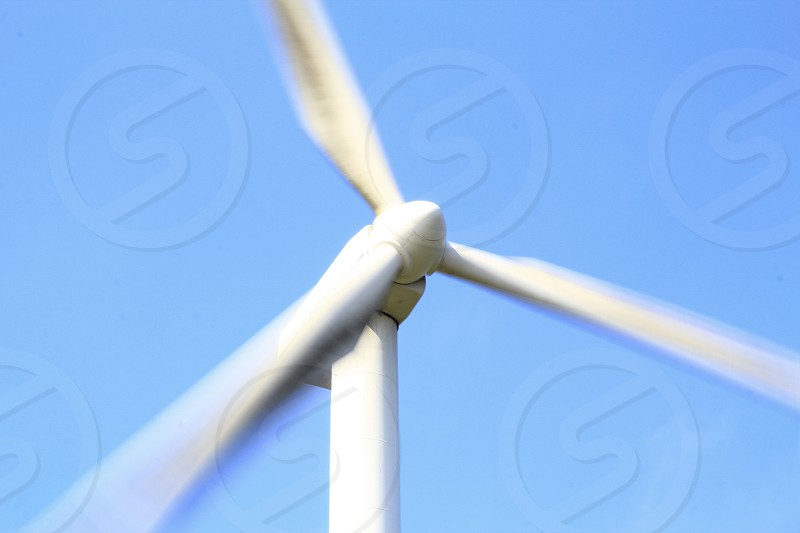 wind turbine that spins and creates renewable electricity. photo