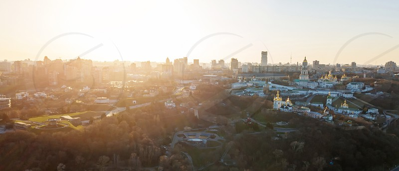 Panoramic view from the drone to the Kiev Pechersk Lavra with architectural monuments at sunset in the summer. Panoramic photography from the drone. photo