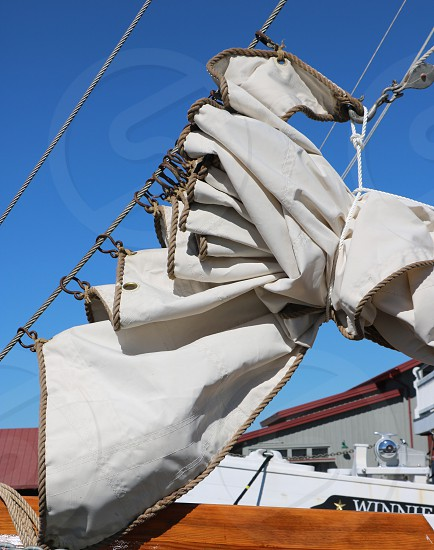 Close-up of folded sails on a boat photo