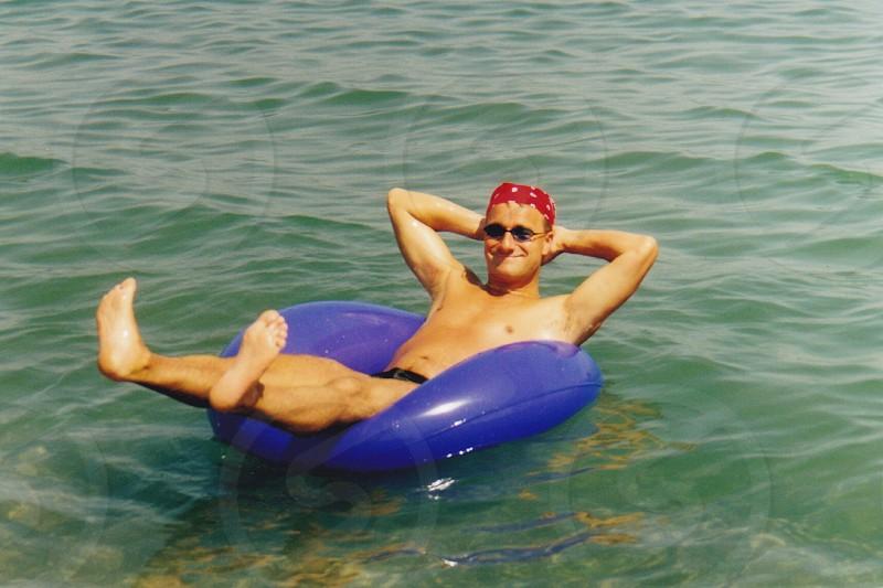 Male sunglasses sea inflatable ring summer fun bandana floating  photo