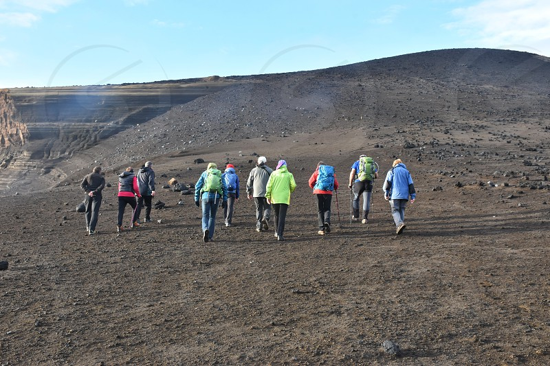 Hiking on Capelinhos volcano on island of Faial in the Azores photo
