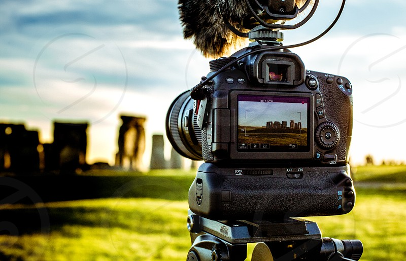 A digital SLR camera recording video/film of Stonehenge in England. photo