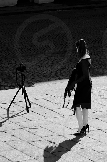 woman wearing black dress facing camera gray scale photography photo