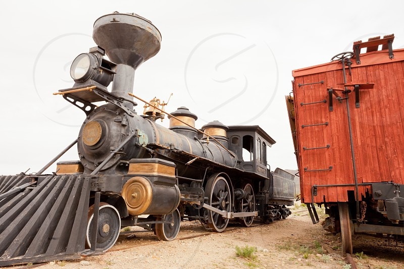 Historic western frontier pioneer railroad train locomotive iron steel steam engine parked in Old Tucson Studios near Tucson Arizona AZ USA photo