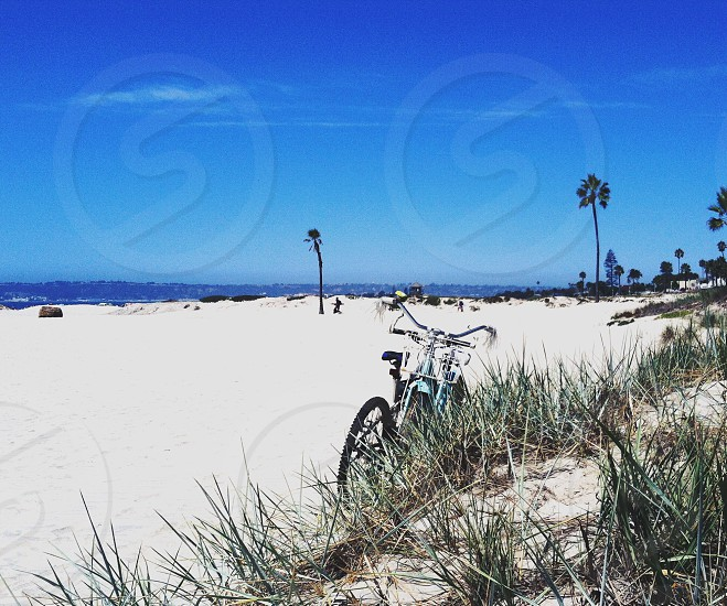 blue gray and black bike on sea shore photo