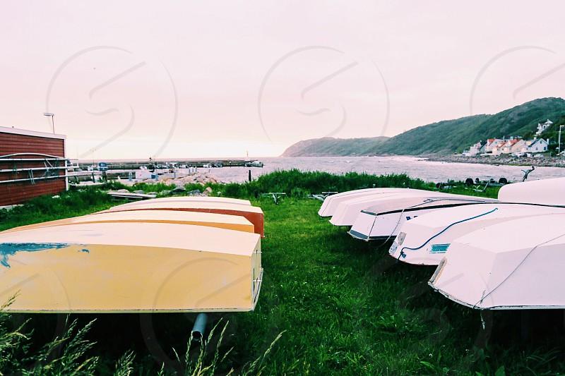 Boating lifestyle  boats sailing sea landscape  land harbor  shore photo