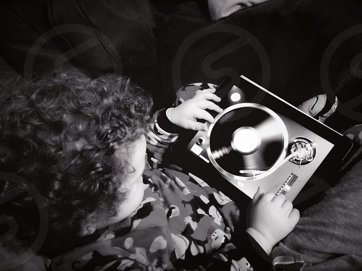 Toddler playing records on an iPad photo