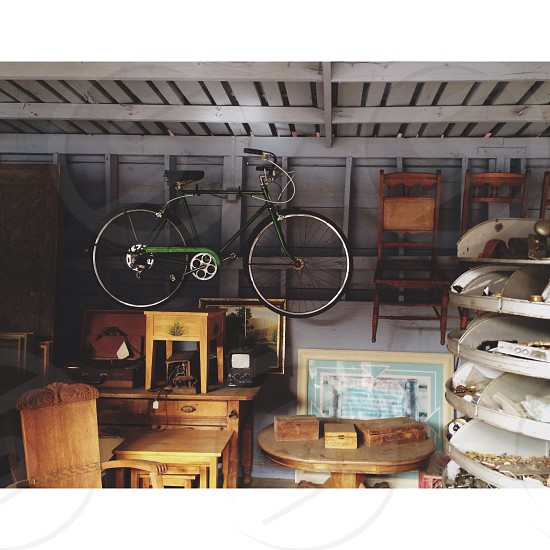 black and green bicycle hanged   on ceiling  photo