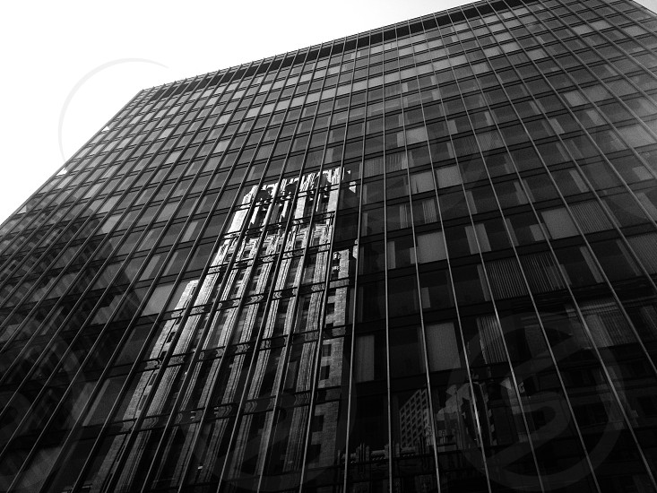 lower angle view of high rise glass building photo