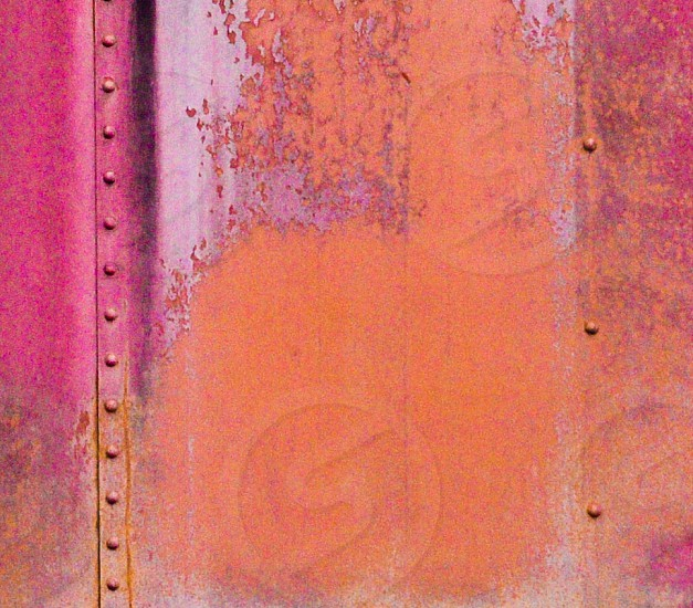 red and orange steel wall photo