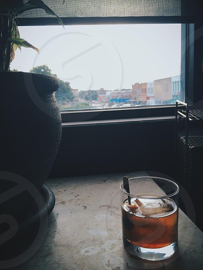 Old fashioned and a window at dusk.  photo