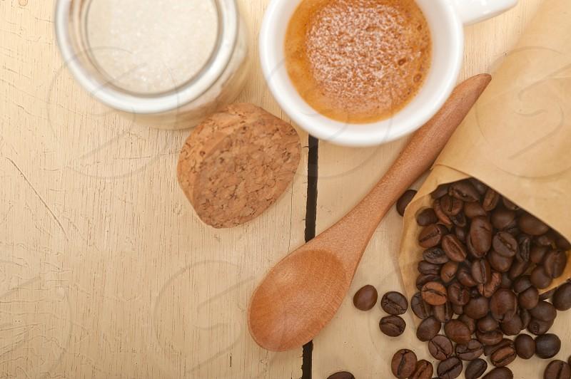 espresso coffee and beans on a paper cone cornucopia over white background photo