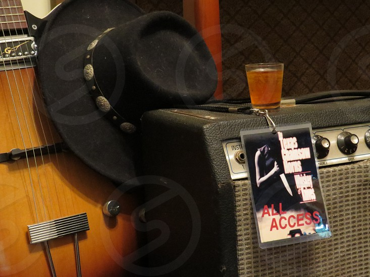 Guitar cowboy hat amplifier shot of whiskey and an All Access backstage pass. photo