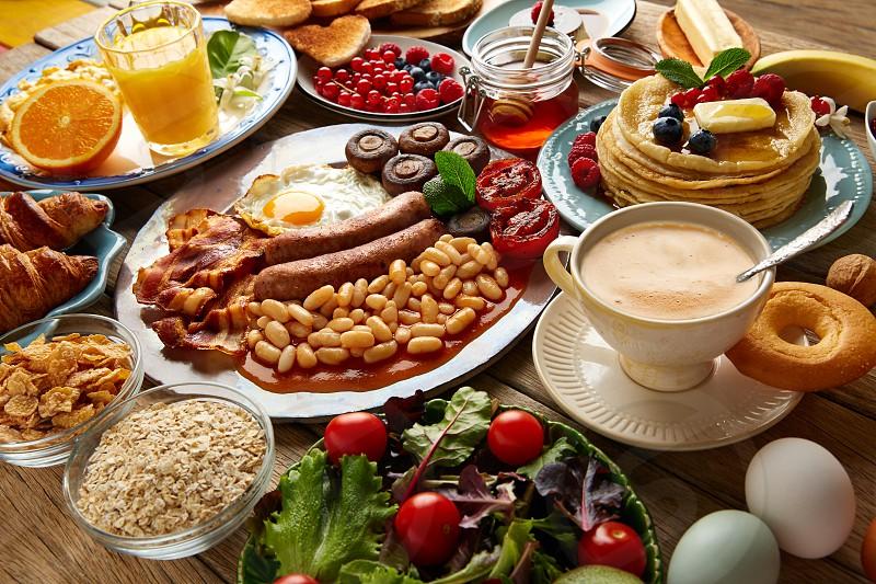 Breakfast buffet full continental and english coffee orange juice salad croissant fruit photo
