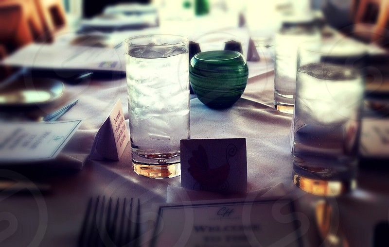 Glasses of water on table in restaurant photo