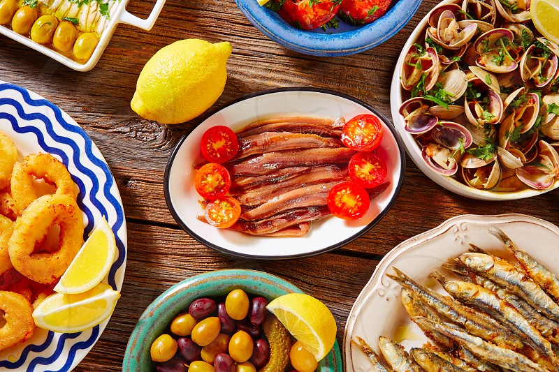 Tapas spanish seafood clams shrimps and fried anchovies fish photo