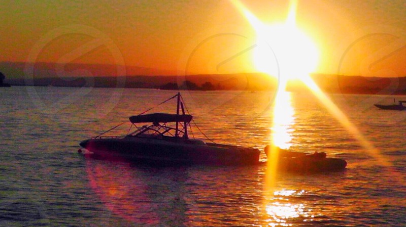 Boat sun sunset water lake photo