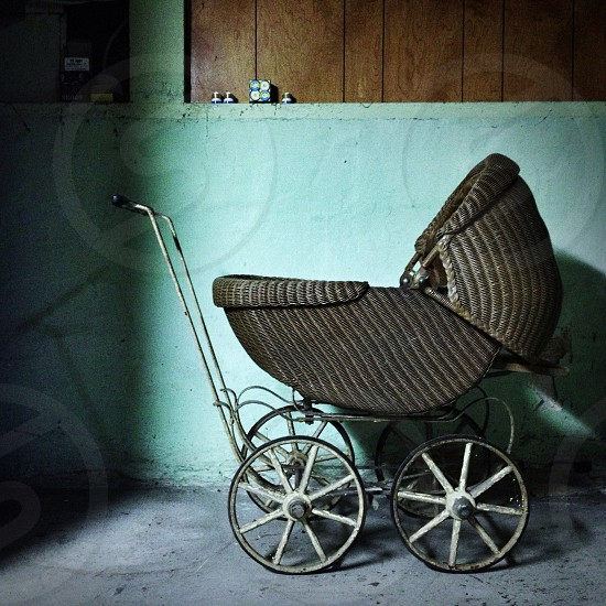 brown woven  baby carriage photo