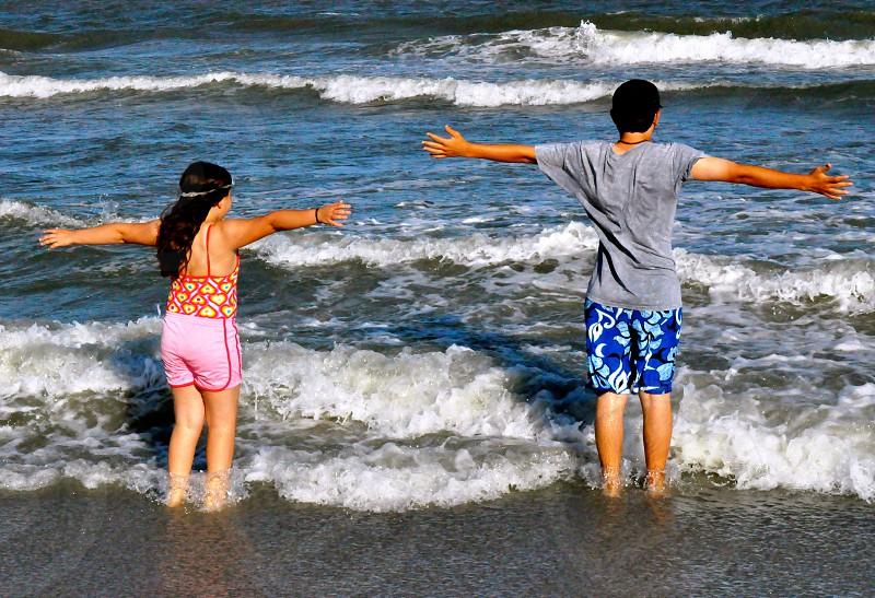 Kids watching the waves photo