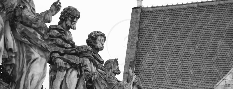 male statuettes beside roof photo