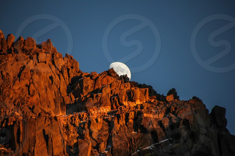 moon's view from the brown rocky hill photo