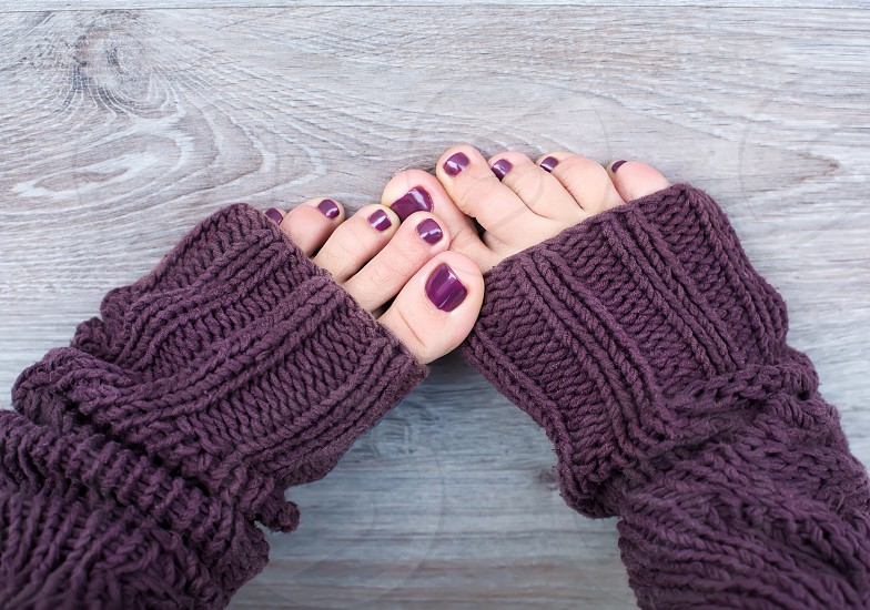 Feet in knitting socks girl women warm home cute pedicure winter spring thread  photo
