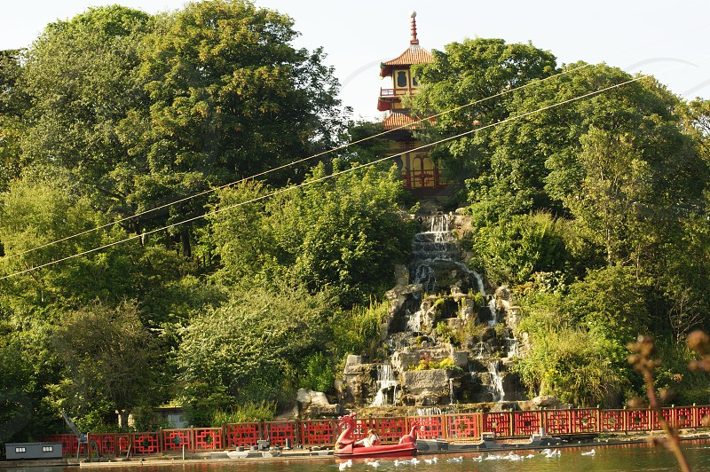 UK. ENGLAND. Scarborough Peasholm Park. The Pagoda on an island in the parks lake with the cascade photo