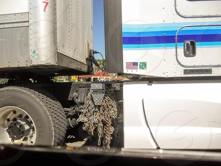 Semi truck semi truck chains wheels 18 Wheeler  photo