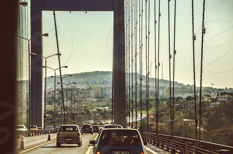 Cars crossing the Bosphorus bridge in Istanbul Turkey. photo