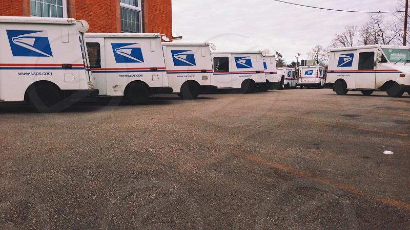 mail delivery trucks on parking lot photo
