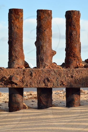 Norfolk Beach North Sea metal rust pillars England photo