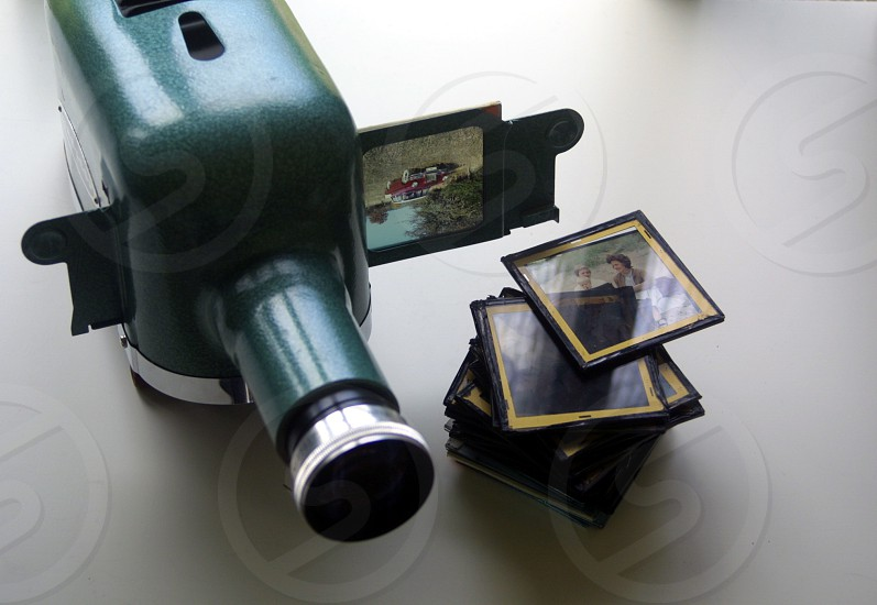 Glass framed slides with a classic UNISCOP projector to show slides photo