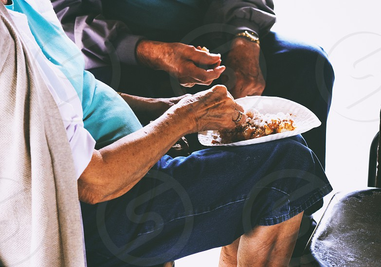 Elderly couple sharing a funnel cake photo