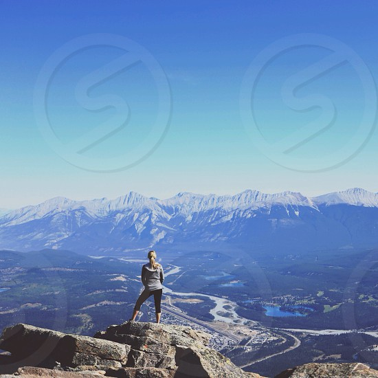 woman standing in mountain clip view photo