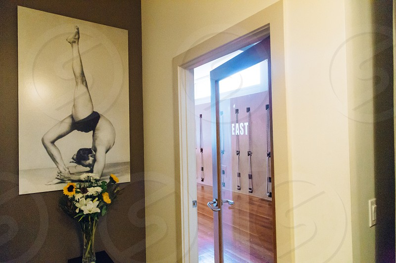man acrobatic pose painting beside door photo