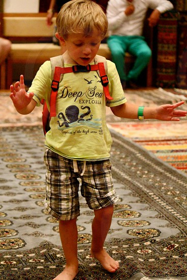 Alex playing with carpets in Turkey  photo