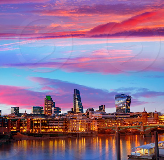 London skyline sunset on Thames river reflection at UK photo