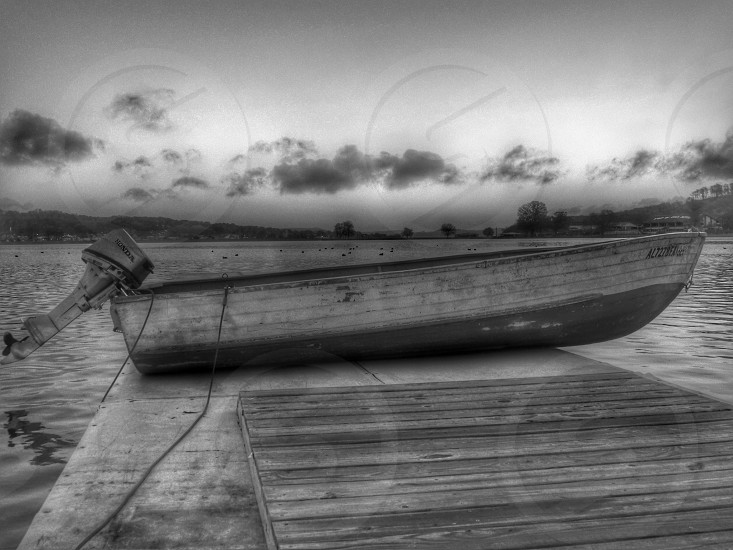 brown wooden motorboat on a wooden pier photo