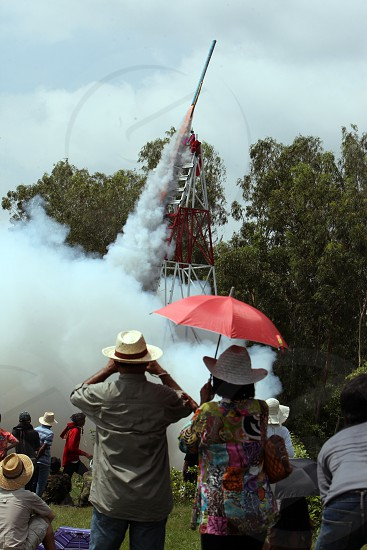 a start of a rocket at the Bun Bang Fai Festival or Rocket Festival in the City of Yasothon in the Region of Isan in Northeast Thailand in Thailand. photo