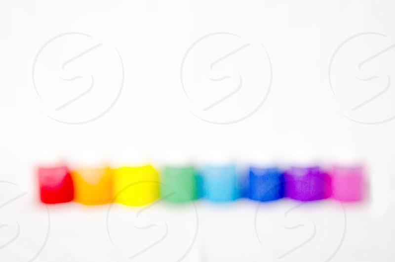 Out of focus paint jars colors rainbow photo