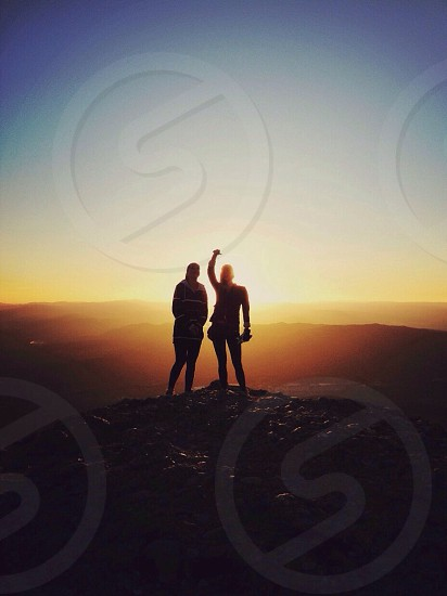 2 human silhouette with sunset background photo