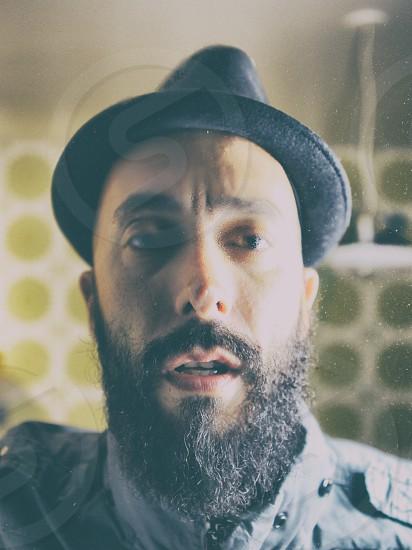 man in black hat photo
