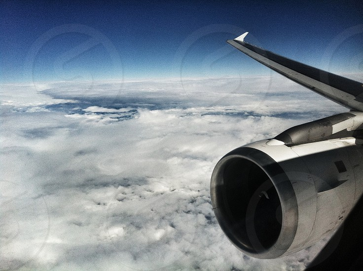 Aeroplane engine wing clouds flight travel photo