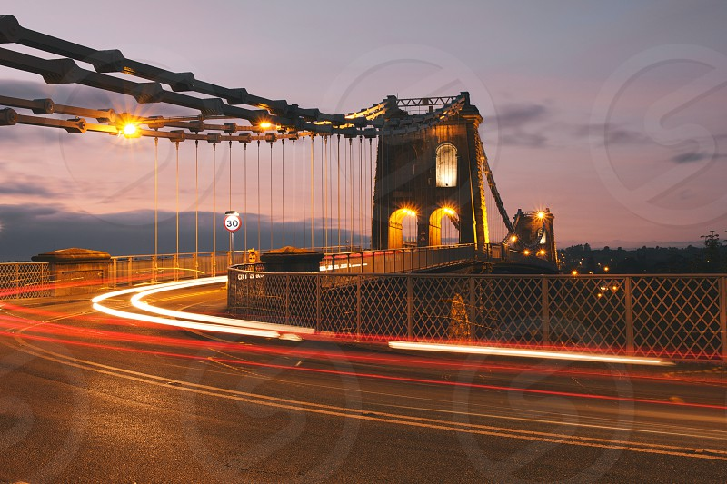 Rush hour traffic trails at the Menai Bridge on the Isle of Anglesey North Wales UK. photo