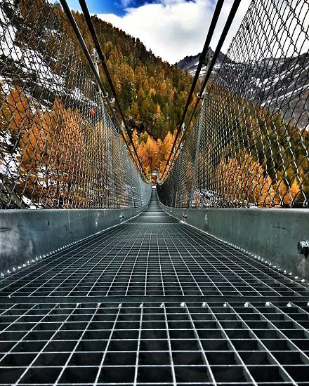 Through  and connect  #bridge #zermatt #switzerland photo