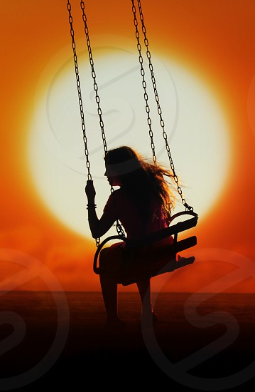 woman riding on swing photo