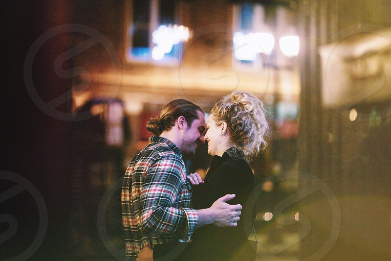 man and woman dancing during night time photo