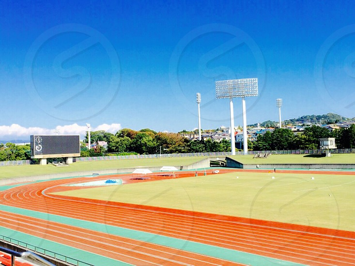 track and field under clear blue skies photo