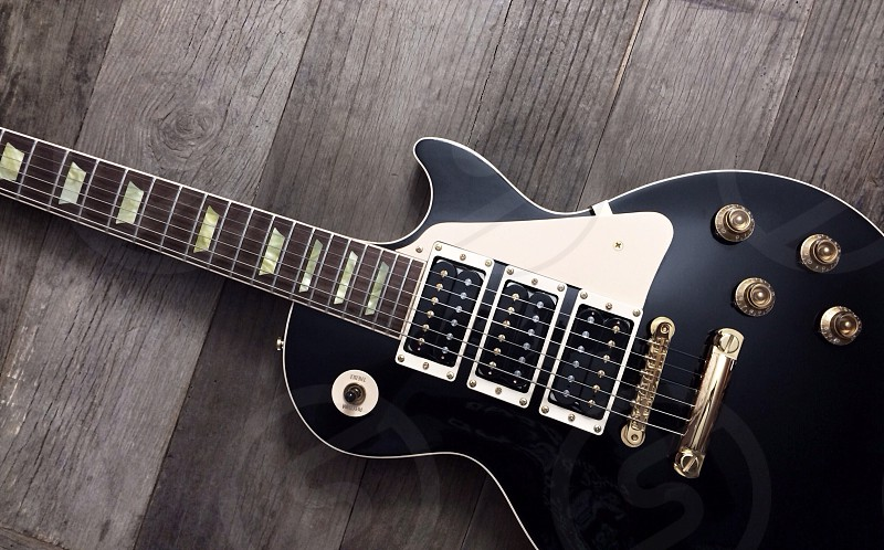 black and white electric guitar photo