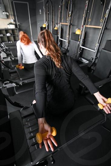 Female fitness. Weight training. Cross Training. photo